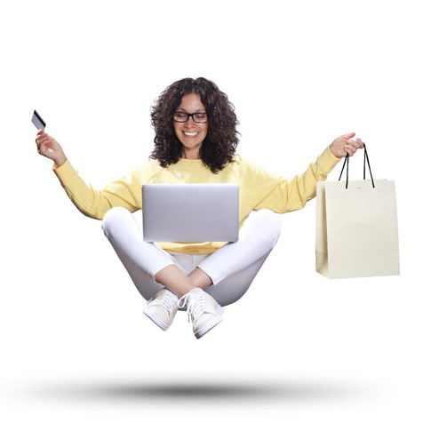 Beautiful woman with laptop and package hanging in the air